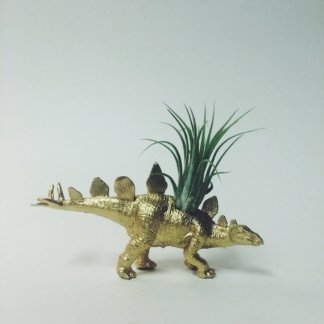 Gold stegosaurus from TwoTreesBotanical on Etsy.